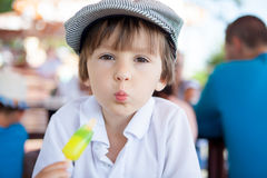 Cute sweet boy, child, eating colorful ice cream in the park Royalty Free Stock Photo