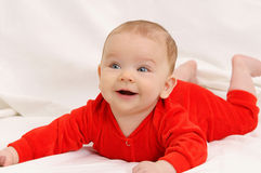 Cute sweet little baby girl on white sofa Stock Image