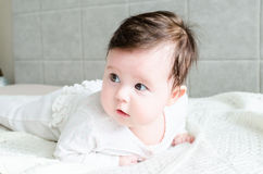 Cute sweet little newborn baby girl lying on bed Royalty Free Stock Photo
