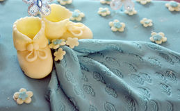 Cute sweet shoes on a baby boy birthday cake Royalty Free Stock Images