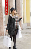 Cute sweet woman in winter day for shopping royalty free stock photos