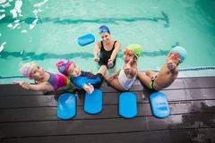 Cute swimming class and coach smiling Stock Photography