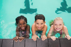 Cute swimming class in pool with coach Royalty Free Stock Photography