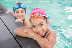 Cute swimming class in the pool Royalty Free Stock Images