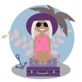Cute tanned blond girl traveler sitting on the luggage under the palm royalty free stock image