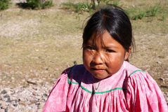 Cute Tarahumara girl  wearing traditional bright outfit in Coppe Royalty Free Stock Image