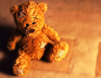 Cute teddy. This teddy s sitting by a warm cosy fire, which makes him even warmer to cuddle up to Royalty Free Stock Photos