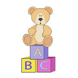 Cute teddy with alphabet toy cubes Royalty Free Stock Images