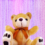 Cute Teddy Bear. With a Pretty Bow on a Decorative Background royalty free stock images