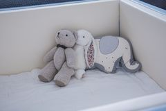 Cute teddy bear in baby nursery stock photos