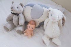 Cute teddy bear in baby nursery royalty free stock photography