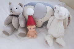 Cute teddy bear in baby nursery stock photo
