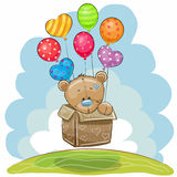Cute Teddy Bear with balloons. Cute Teddy Bear in the box is flying on balloons Royalty Free Stock Image