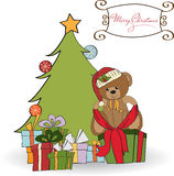 Cute teddy bear with a big Christmas gift Stock Image