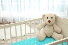 Cute teddy bear. In child`s bed Royalty Free Stock Photos