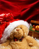 A cute teddy bear in a Christmas hat Stock Image