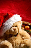 A cute teddy bear in a Christmas hat Stock Photo