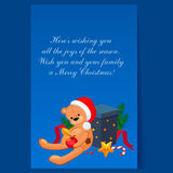 Cute Teddy Bear in a Christmas Hat Sitting near. Gift. Holiday Vector Illustration Stock Photography