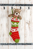 Cute Teddy Bear with christmas stocking sock decoration Royalty Free Stock Image