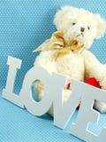 Cute teddy bear concept valentine day on blue polka dot background Royalty Free Stock Photos