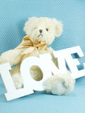 Cute teddy bear concept valentine day on blue polka dot background Royalty Free Stock Photo