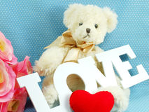 Cute teddy bear concept valentine day on blue polka dot background Stock Photos