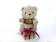 Cute Teddy Bear with Elegance Golden Gift Box Stock Photo