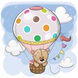 Cute Teddy Bear is flying on a hot air balloon. Cute Cartoon Teddy Bear is flying on a hot air balloon vector illustration