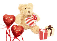 Cute teddy bear with gifts Valentine's day Stock Photos
