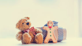 Cute teddy bear, gingerbread man and beautiful gift on the wonde Royalty Free Stock Photos