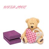 Cute teddy bear with a heart and gift box for jewelry Royalty Free Stock Photos