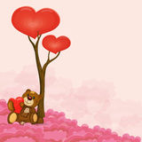 Cute teddy bear with heart in his hand near love tree sitting on cloud Royalty Free Stock Images