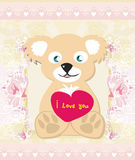 Cute Teddy bear with heart Stock Photos
