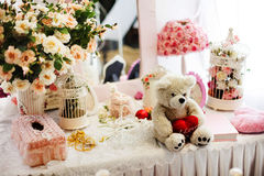 Cute teddy bear with a heart in pink still life Royalty Free Stock Images