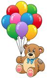 Cute teddy bear holding balloons Stock Photo