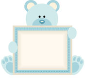 Cute teddy bear holding blank sign for baby boy announcement Royalty Free Stock Images