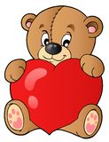 Cute teddy bear holding heart Royalty Free Stock Photography