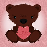 Cute teddy bear holding a heart Royalty Free Stock Images