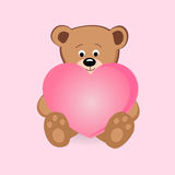 Cute teddy bear holding pink heart Stock Images