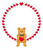 Cute Teddy Bear holding red hearts Royalty Free Stock Photography
