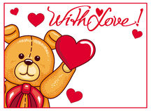 Cute Teddy Bear holding red hearts Stock Image