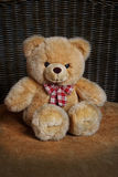 Cute teddy bear with red bow. Sitting Stock Images