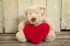 Cute teddy bear with red heart Royalty Free Stock Photos