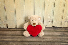 Cute teddy bear with red heart Stock Photography