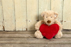 Cute teddy bear with red heart Stock Photos