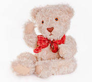 Cute teddy bear saying hi. Sitting teddy bear with red bow saying hi Royalty Free Stock Image