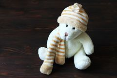 Cute teddy bear sitting on old wood background royalty free stock photography