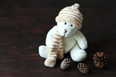 Cute teddy bear sitting on old wood background royalty free stock image