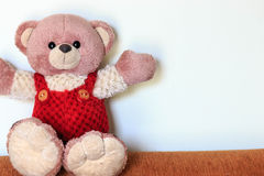 Cute teddy bear sitting on sofa Royalty Free Stock Images