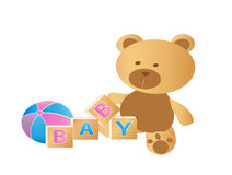 Cute Teddy Bear sitting with toys Royalty Free Stock Photography